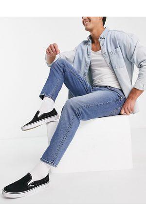 ASOS DESIGN Stretch tapered jeans in dark wash-Blue