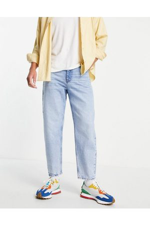 ASOS DESIGN Relaxed tapered jeans in 'less thirsty' light wash-Blue