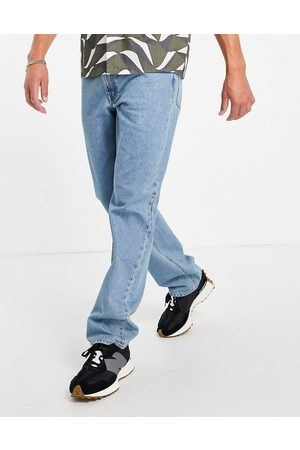 ASOS DESIGN Straight leg jeans in tinted light wash blue