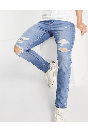 Levi's 512 slim tapered fit distressed jeans in mid wash blue