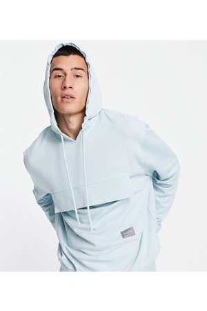 ASOS Unrvlld Spply Co-ord relaxed hoodie with logo print and front pocket in blue