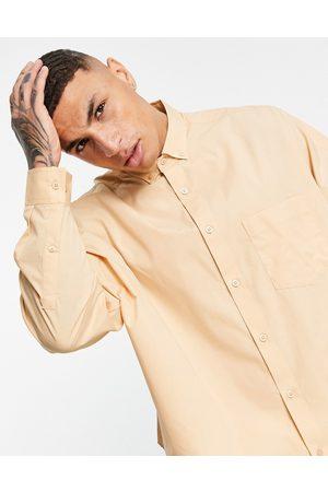 ASOS DESIGN Extreme oversized dad shirt in -Brown