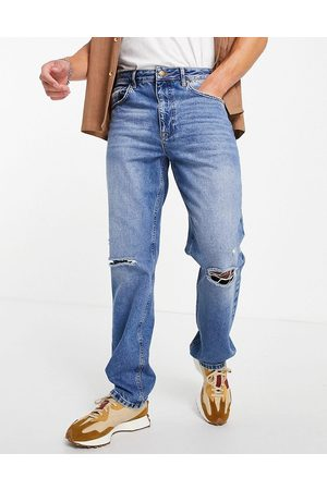 ASOS DESIGN Straight leg jeans in vintage mid wash with knee rips-Blue