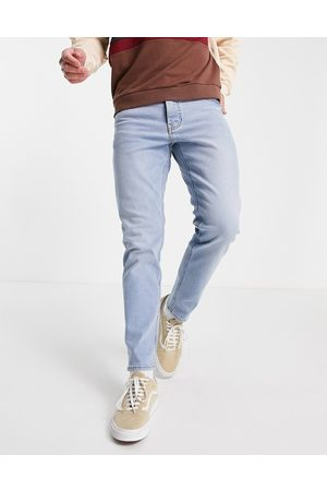 ASOS DESIGN Stretch tapered jeans in light wash-Blue