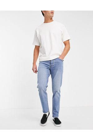 ASOS DESIGN Stretch tapered jeans in mid wash-Blue