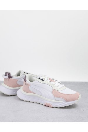 PUMA Wild Rider trainers in off white and pastel pink-Neutral