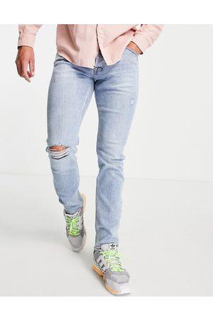 JACK & JONES Intelligence Glenn slim fit jeans with knee rip in lightwash blue