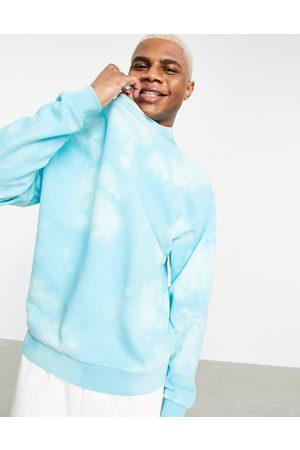 ASOS Oversized sweatshirt in light blue bleach wash