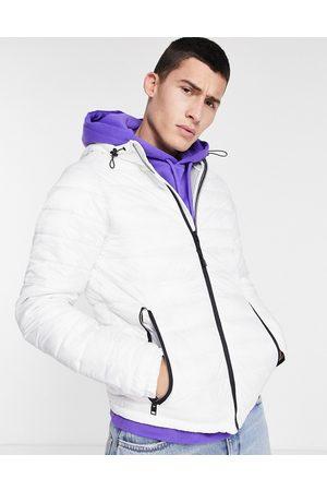 Bershka Quilted hooded jacket in
