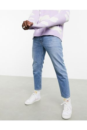 ASOS Classic rigid jeans in 'less thirsty' wash in light blue