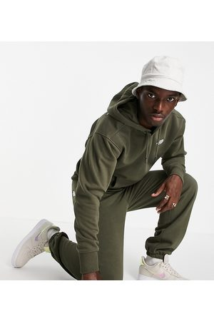 The North Face Men Sports Leggings - Oversized Essential trackies in khaki Exclusive at ASOS-Green
