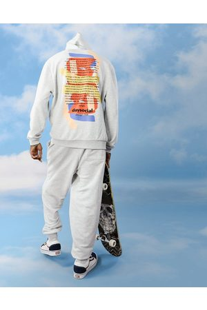 ASOS ASOS Daysocial co-ord relaxed hoodie with abstract shape back print and logo embroidery in white marle