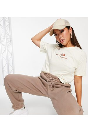 The North Face Logo cropped T-shirt in cream Exclusive to ASOS-White
