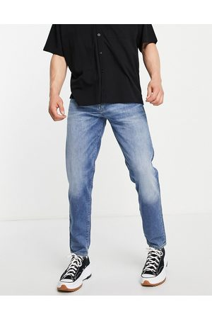 SELECTED Organic cotton blend slim tapered jeans in light blue made from hemp
