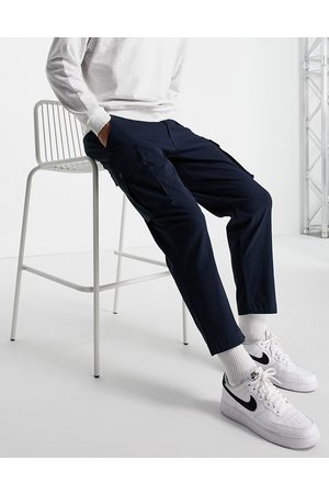 SELECTED Loose fit tapered cargo pants in navy with organic cotton