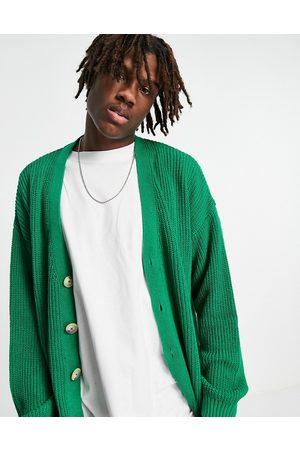 ASOS DESIGN Knitted oversized fisherman rib cardigan in