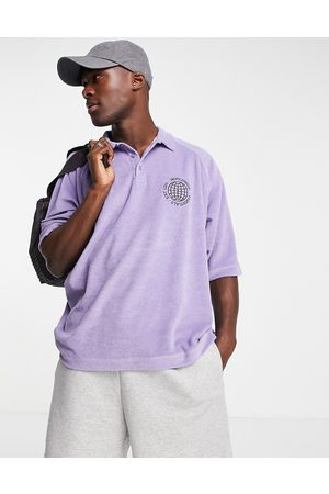 ASOS DESIGN Relaxed polo t-shirt in purple towelling with chest embroidery