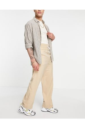 ASOS DESIGN Men Chinos - Wide leg smart pants with elasticated waist band in cross hatch-Neutral