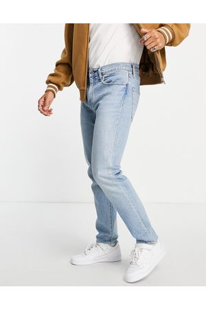 Levi's 502 tapered jeans in mid