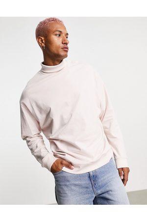 ASOS Men Sweatshirts - Oversized sweatshirt with funnel neck in pink