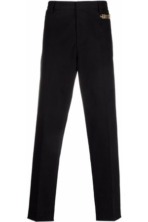 Moschino Logo embellished tailored trousers