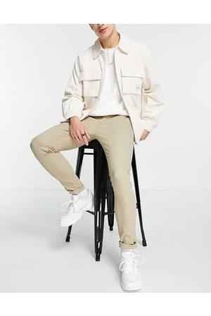 ASOS DESIGN Super skinny chinos in beige-Neutral