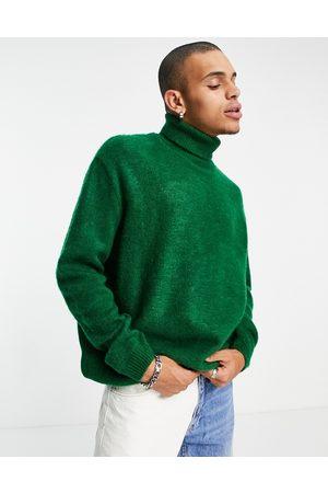 ASOS DESIGN Fluffy knit roll neck jumper in