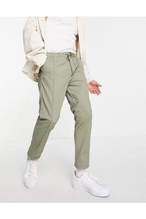 ASOS Skinny chinos with elasticated waist and pintuck in light -Green