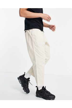 Gramicci Men Chinos - Loose tapered pants in white