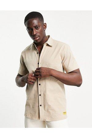 Cat Footwear Men Short sleeves - Caterpillar short-sleeved logo pocket shirt in -Neutral