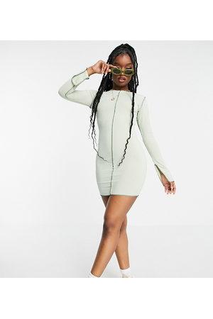 Missyempire Exclusive contrast stitch mini dress in -Green