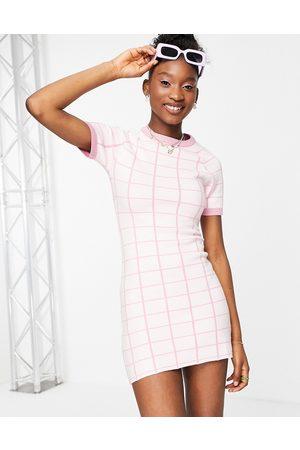 Liquorish Knitted mini dress with split in check