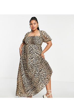 ASOS Curve ASOS DESIGN Curve shirred bustier maxi dress with puff sleeve in seersucker in -Multi