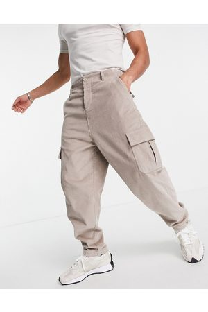 ASOS Oversized tapered fit pants with cargo pockets in cord-Neutral