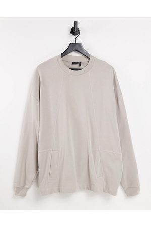 ASOS Long sleeve oversized t-shirt with pockets and stepped hem in beige-Neutral