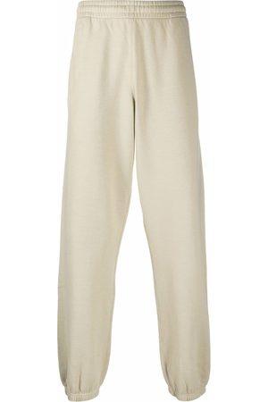 OFF-WHITE Men Joggers - Arrow print slim track trousers