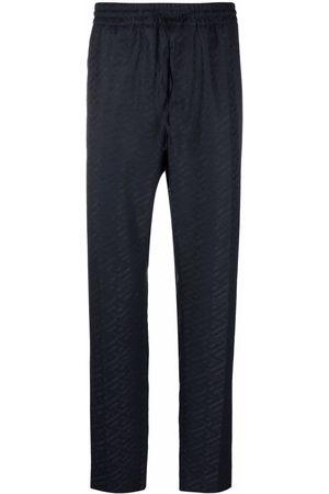 VERSACE Men Joggers - Greca-print trousers