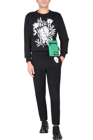 McQ JOGGING PANTS WITH EMBROIDERED SKULL