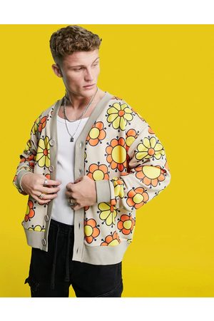 ASOS Oversized jersey cardigan in beige with all over flower print-Pink