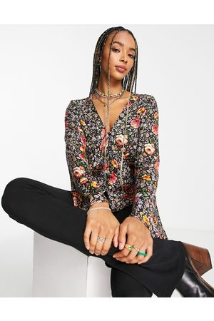 Topshop Jacquard button-front flute sleeve blouse in floral
