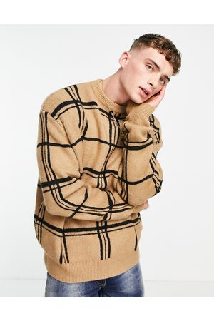 Mennace Oversized knitted jumper in with black check