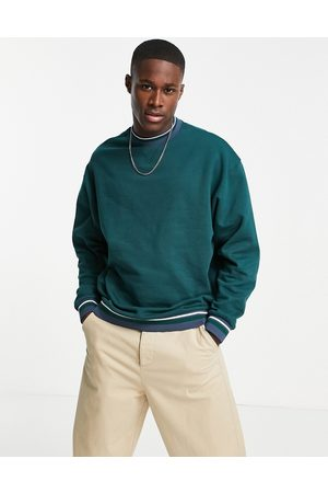 ASOS Oversized sweatshirt with tipping in forest green