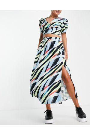 Liquorish Wrap midi skirt in abstract print