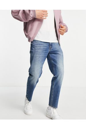 ASOS Classic rigid jeans in dirty dark wash blue
