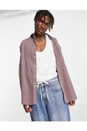 ASOS Oversized shirt with stepped hem in stripe