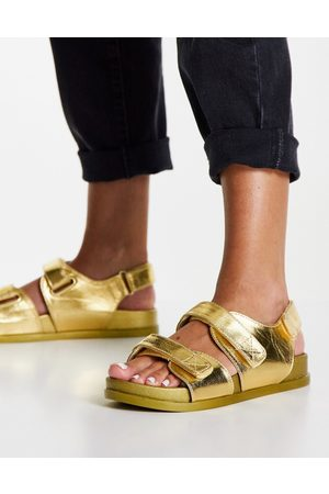 ASOS Factually sporty sandals in gold