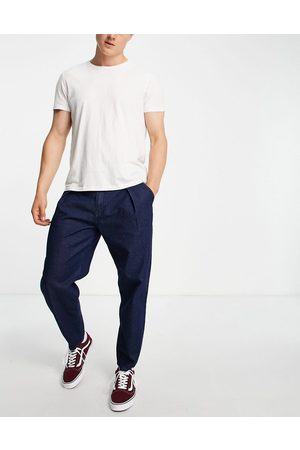 ASOS Men Bootcut & Flares - Relaxed tapered pleated jeans in dark blue