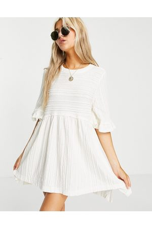 Free People Take A Spin tunic top with frill sleeves in textured stripe-White