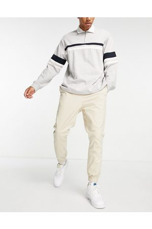 ASOS Tapered chino trackies with elasticated waist in beige-Neutral