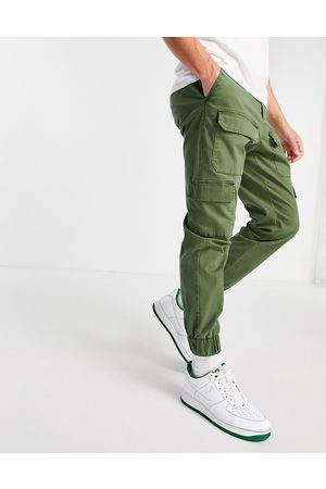 ASOS Tapered pants with multi pockets in khaki-Green
